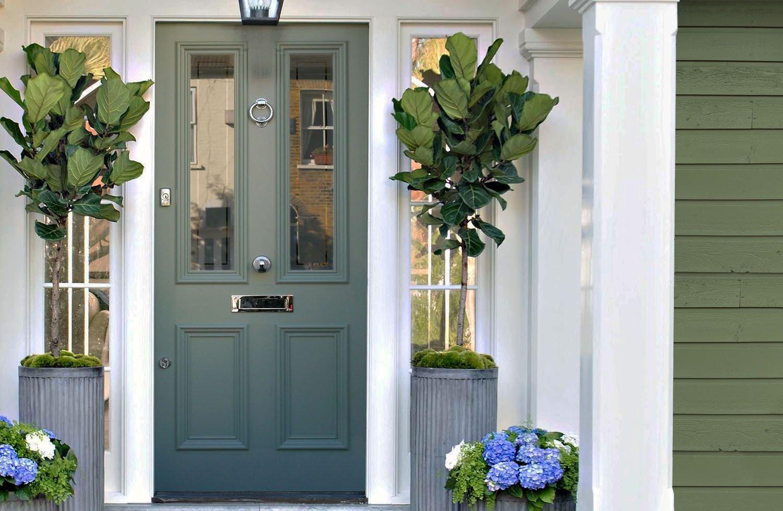 porta verde feng shui prego e martelo